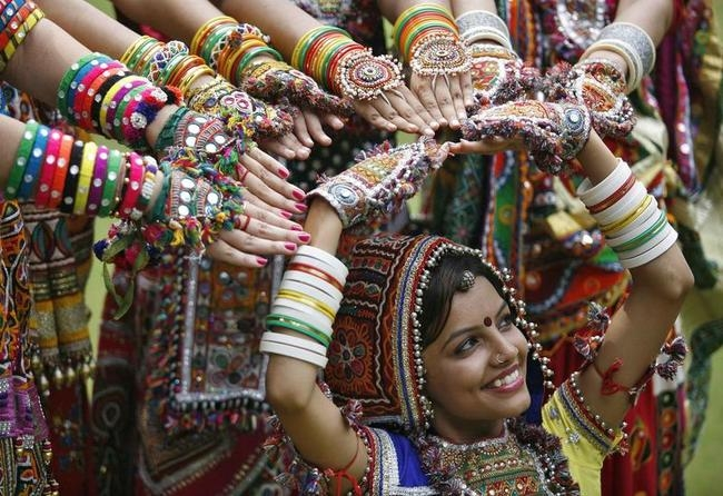 A girl dressed in traditional attire poses as she takes part in rehearsals for garba dance ahead of Navratri festival in Ahmedabad
