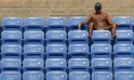 A tennis fan watches play at the 2014 U.S. Open tennis tournament in New York