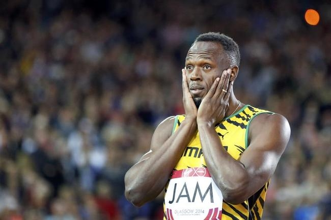Bolt of Jamaica gestures before competing in a heat of the men