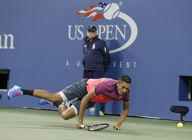 Nick Kyrgios of Australia falls while going after a return to Tommy Robredo of Spain during their men