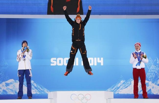Gold medalist Wust of Netherlands, silver medalist Sablikova of Czech Republic and bronze medalist Graf of Russia celebrate during the medal ceremony for women