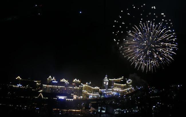 Fireworks explode over the ski resort of Rosa Khutor, near Sochi, during the Sochi 2014 Winter Olympics