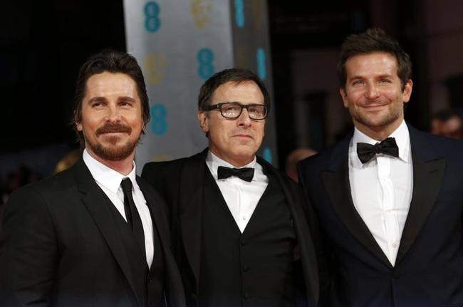 Actor Christian Bale, director David O. Russell and actor Bradley Cooper arrive at the British Academy of Film and Arts awards ceremony in London