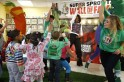 U.S. first lady Michelle Obama dances and exercises along with children led by trainer Roger Hanson of the Super Sprowtz at a La Petite Academy child care center in Bowie, Maryland