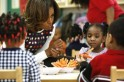 U.S. first lady Michelle Obama talks about heathy snacks with children at a La Petite Academy child care center in Bowie, Maryland