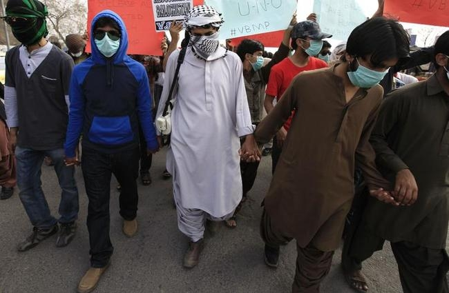 Relatives of people who have gone missing in Pakistan's restive province of Baluchistan walk towards Islamabad, in Rawalpindi