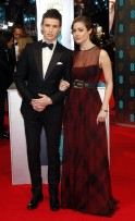 Actor Eddie Redmayne and Hannah Bagshawe arrive at the British Academy of Film and Arts awards ceremony at the Royal Opera House in London