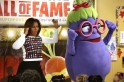 U.S. first lady Obama dances with an eggplant from the Super Sprowtz at a La Petite Academy chid care center in Bowie