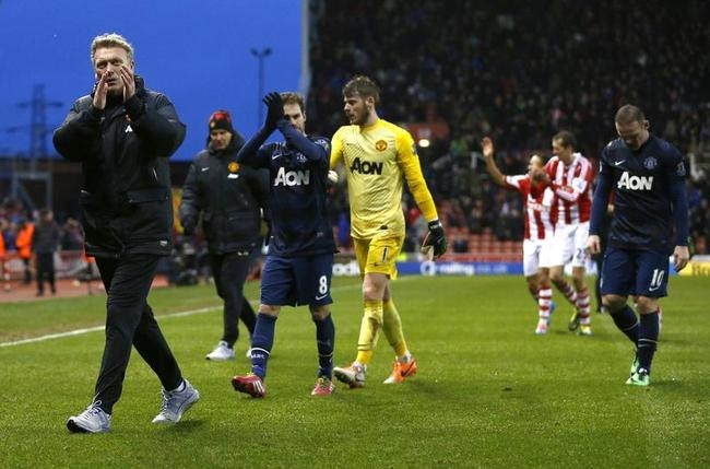 Manchester United manager Moyes reacts after their English Premier League soccer match against Stoke City at the Britannia Stadium in Stoke-on-Trent
