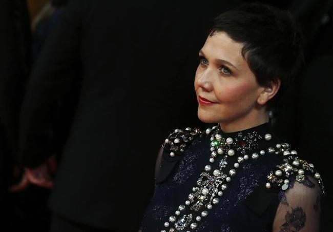 Maggie Gyllenhaal arrives at the British Academy of Film and Arts (BAFTA) awards ceremony at the Royal Opera House in London