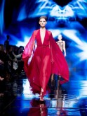 Model Karlie Kloss presents a creation of Donna Karan New York during New York Fashion Week