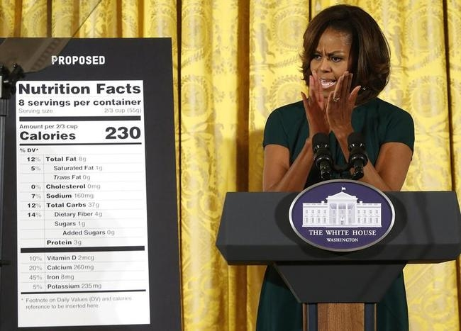 US first lady Obama applauds as she unveils proposed updates to nutrition facts labels during remarks in the East Room of the White House in Washington