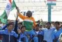Indian captain Anand Amritraj being lifted