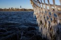 Ice forms on the shore of the East River due to unusually low temperatures caused by a Polar Vortex in New York