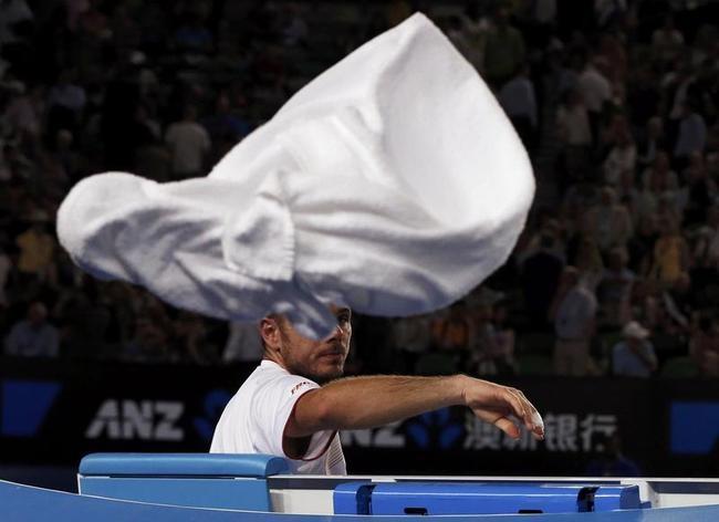 Stanislas Wawrinka of Switzerland throws a towel behind him during a break in play of his men