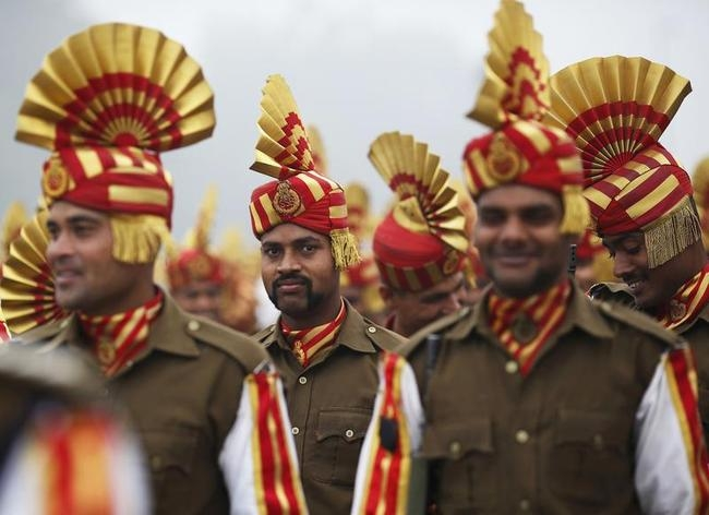 Indian soldiers take part in rehearsal for Republic Day parade amid fog on cold winter morning in New Delhi