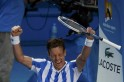 Tomas Berdych of the Czech Republic celebrates defeating David Ferrer of Spain in their men
