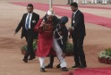 An Indian soldier is carried away after he fainted minutes before the arrival of South Korean President Park during a ceremonial reception in New Delhi