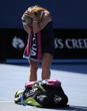 Dominika Cibulkova of Slovakia reacts after defeating Agnieszka Radwanska