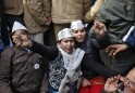 Supporters of the Aam Aadmi (Common Man) Party gesture and shout slogans during a protest in New Delhi