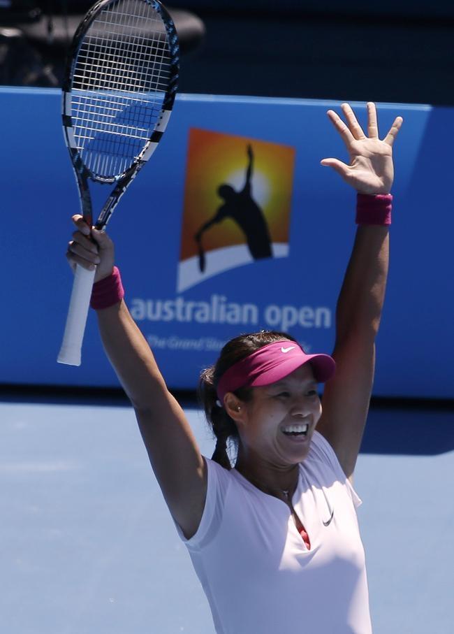 Li Na of China celebrates after defeating Eugenie Bouchard of Canada