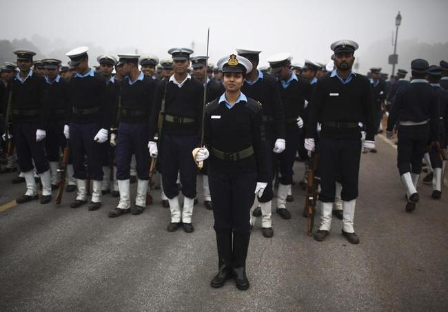 Indian soldiers take part in rehearsal for Republic Day parade amid fog on a cold winter morning in New Delhi