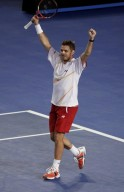Stanislas Wawrinka of Switzerland celebrates defeating Novak Djokovic of Serbia in their men