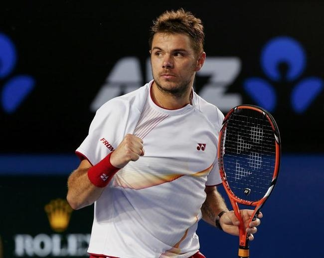 Stanislas Wawrinka of Switzerland celebrates winning the second set in his men