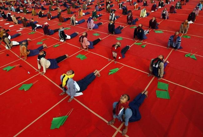 School girls attend a yoga session during a camp in the western Indian city of Ahmedabad