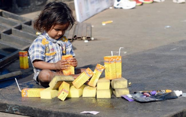 Child with empty juice packets