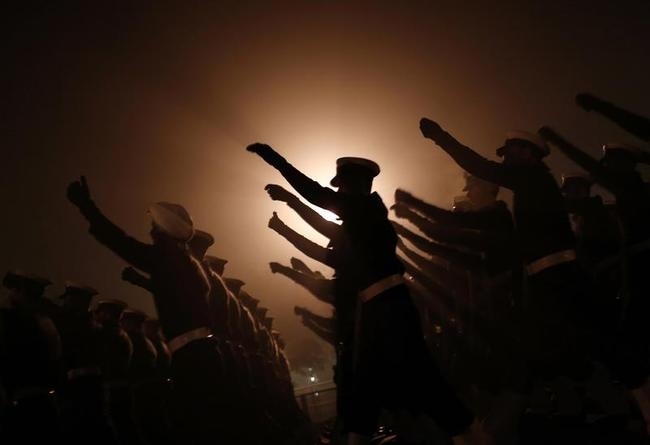 Indian soldiers march during the rehearsal for the Republic Day parade on a cold winter morning in New Delhi