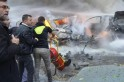 Civil Defence members move a fire extinguisher as a Hezbollah member carries a walkie-talkie at the site of an explosion in the Haret Hreik area, in the southern suburbs of the Lebanese capital Beirut