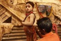 """A boy is dressed-up as Lord Shiva in preparations for an annual pilgrimage to Sagar Island for the one-day festival of """"Makar Sankranti"""", in Kolkata"""
