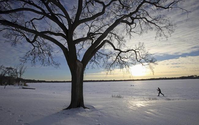 A cross country skier makes his way across Lake Calhoun in Minneapolis
