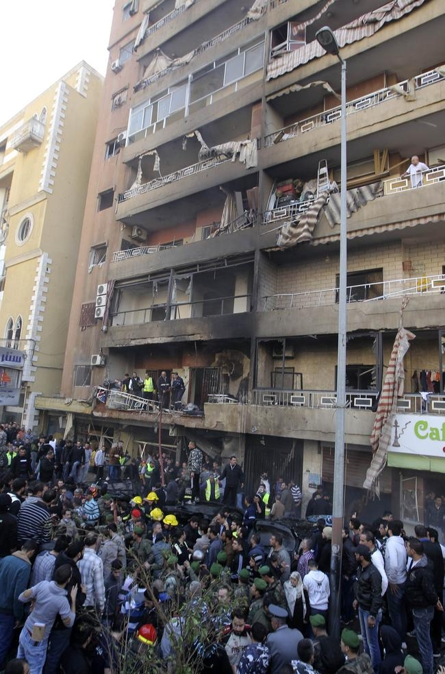 People gather at the site of a bomb blast in the Haret Hreik area, in the southern suburbs of the Lebanese capital Beirut