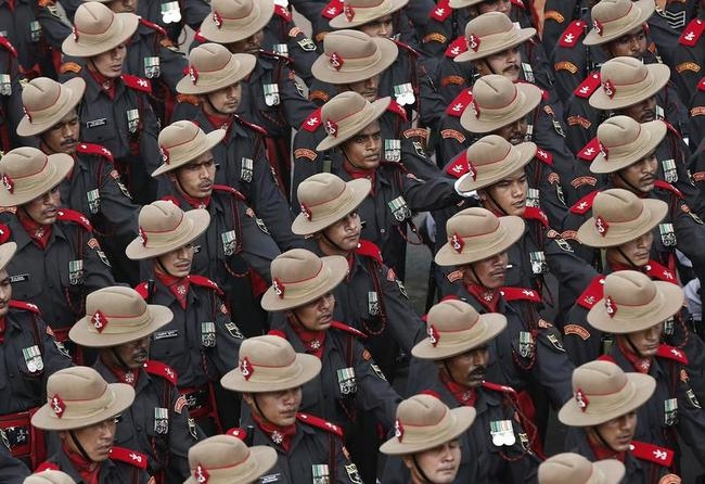 Indian Army soldiers march during the full dress rehearsal for the Republic Day parade in New Delhi
