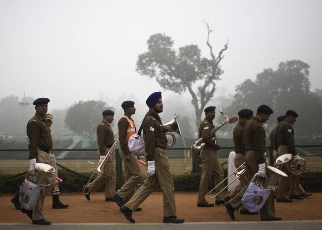 Band members of Indian security force walk after taking part in rehearsal for Republic Day parade amid fog on a cold winter morning in New Delhi
