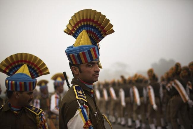 Indian soldiers take part in rehearsal for the Republic Day parade amid fog on a cold winter morning in New Delhi