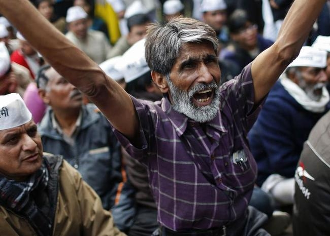 A supporter of the Aam Aadmi (Common Man) Party shouts slogans during a protest in New Delhi