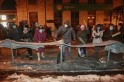 Pro-European protesters beat on metal sheets with wood blocks during a rally in Kiev