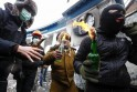Pro-European integration protesters carry Molotov cocktails during clashes with police in Kiev