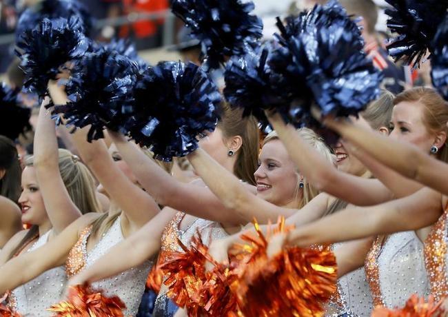Auburn cheerleaders perform inside the Rose Bowl