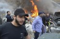 Civil defence members extinguish a fire at a site of an explosion in the Haret Hreik area in the southern suburbs of the Lebanese capital Beirut