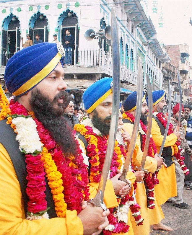 Sikh devotees take out a procession