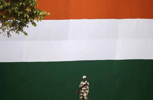 A paramilitary soldier stands guard during the full dress rehearsal for the Republic Day parade in New Delhi