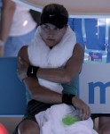 Eugenie Bouchard of Canada cools down with ice towel around her neck during a break as she plays Li Na of China