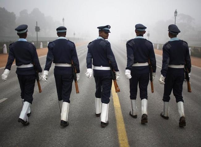 Indian soldiers march during rehearsal for Republic Day parade amid fog on cold winter morning in New Delhi