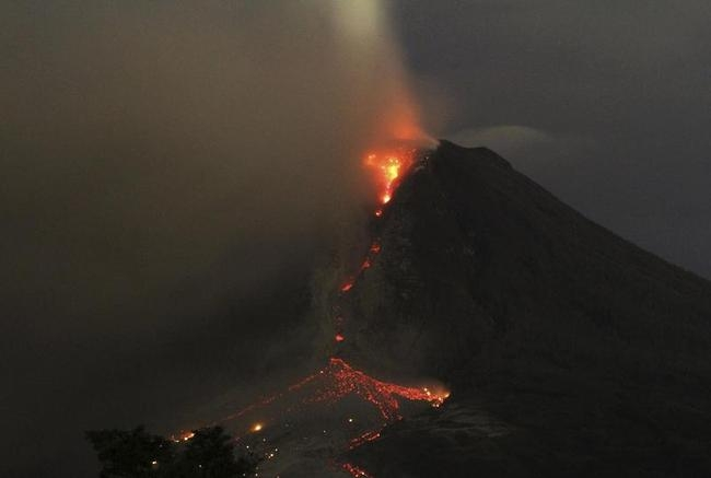 Mount Sinabung volcano spews ash and lava as seen from Erajaya village in Karo district, Indonesia