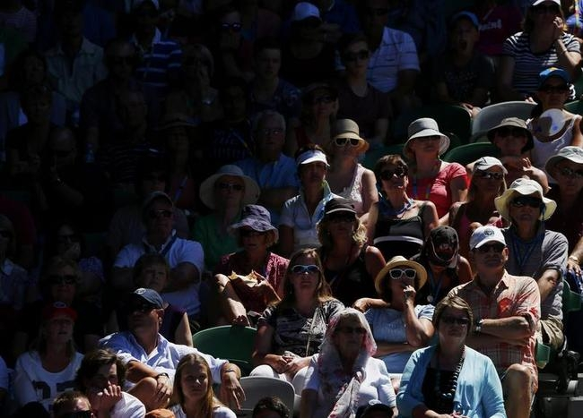 Spectators watch the tennis at Rod Laver Arena at the Australian Open 2014 tennis tournament in Melbourne