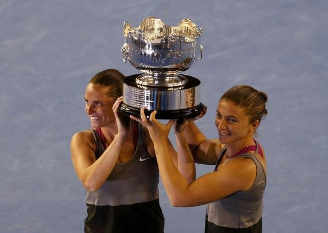 Sara Errani of Italy (R) and Roberta Vinci of Italy pose with the trophy after defeating Ekaterina Makarova of Russia and Elena Vesnina of Russia in their women